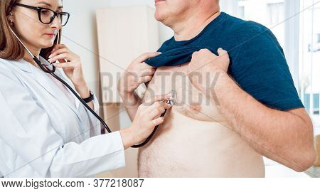 Doctor Cardiologist With Patient In The Hospital. Diagnostic.