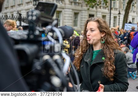 London - October 18, 2019: Dr Emily Grossman Being Interviewed For Tv At An Extinction Rebellion Pro
