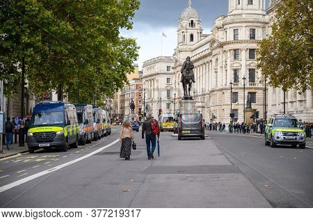 London - October 18, 2019: Police Vans Line Whitehall Near Horse Guards Parade And The Earl Haig Mem