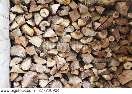 Preparation Of Firewood For The Winter. Stacks Of Firewood At The Home. Pile Of Firewood. Firewood B