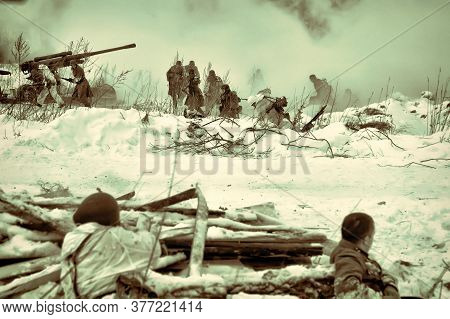 Military Men In Old Uniforms In The Winter At The Reconstruction Of The Second World War On The Day