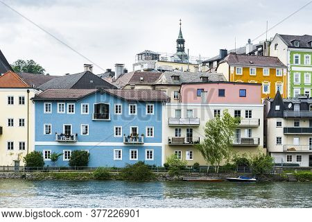 Traditional Austrian Medieval Architecture In The City Of Gmunden. Embankment Of The Traun River In