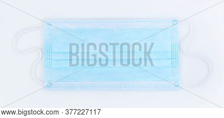 Top View Of Coronavirus Surgical Medical Mask Isolated On White Background, Covid 19 Virus Protectio