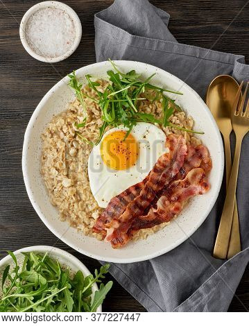 Oatmeal, Fried Egg, Fried Bacon. Balance Of Proteins, Fats, Carbohydrates. Balanced Food. Vertical
