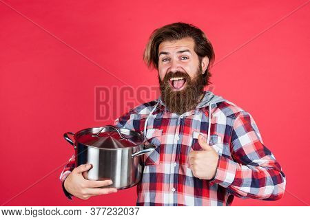 Tastes Good. Cooking Utensils Vessels. Kitchen Advertising. Man With Saucepan. Man Hold New Brand Pa