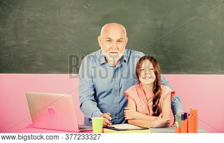 Modern Knowledge. Modern Teaching Method. Student Girl With Teacher Man At Blackboard. Schoolgirl An