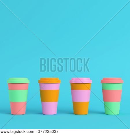 Four Colorful Coffee Cups On Bright Blue Background In Pastel Colors. Minimalism Concept. 3d Render