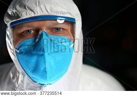 Close Up Portrait Of Doctor Wearing Protective Mask And Glasses While Treating People With Contagiou