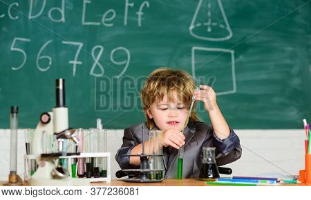 Biology Science. Science Experiments With Microscope In Lab. School Kid Scientist Studying Science.