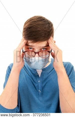 Tired Young Man In A Flu Mask Isolated On The White Background