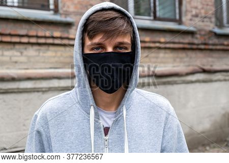Young Man In The Flu Mask On The Old House Background On The Street
