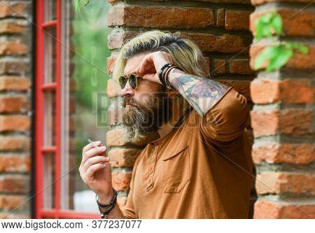 Cool Guy Relaxing. Went On Smoke Break. Hipster Smoking Irish Pub Entrance Background. Smoking Outdo