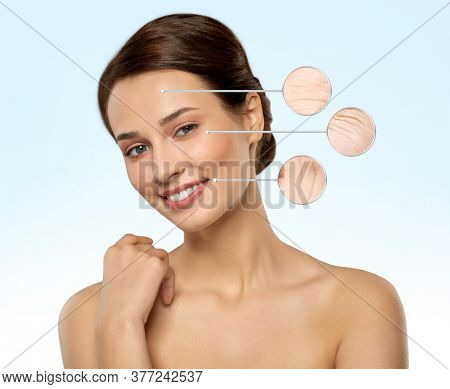 beauty, skincare and people concept - beautiful young woman with face wrinkles in zoomed pointers over blue background