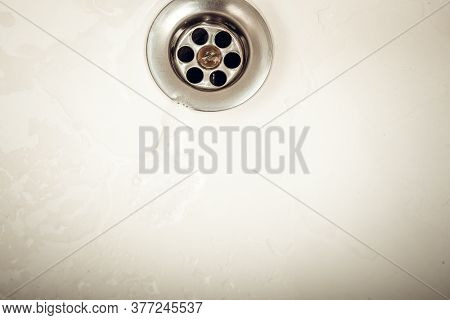 Water Draining At Sink Background. Water Flowing Drain In Washbasin