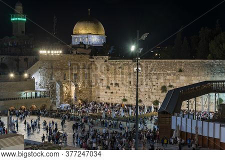 Religious Jewish And Tourists Prayer Before The Western Wall In Jerusalem Old City In Israel. Wester