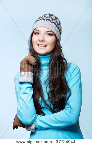 smiling woman in cap and mittens