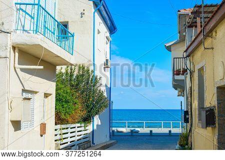 Larnaca, Cyprus - Feb 17, 2019: Empty Street Leading To The Sea In Larnaca, Cyprus