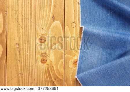 jeans texture on old wooden background, table surface