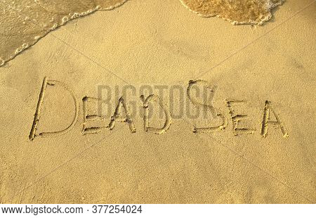 Dead Sea Words On Beach Sand. Dead Sea Phrase Is Written On A Sand.