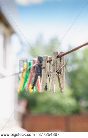 Group Of Different Clothespin For Clothes Are On Clothesline Rope. Close Up View