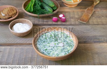 Okroshka, A Traditional Dish Of Russian Cuisine. Cold Soup In A Deep Plate With Sour Cream And Veget
