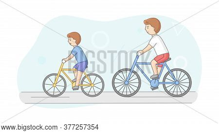 Weekend Time Leisure, Fatherhood And Friendship Concept. People Riding Bicycle In Park. Father And S