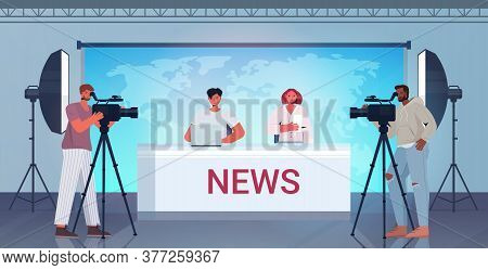Presenters Broadcasting With Cameramen On Television People Discussing Daily News At Modern Tv Studi