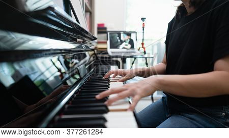 Scene Of Piano Lessons Online Training Or E-class Learning While Coronavirus Spread Out Or Covid-19