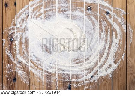 Flour Scattered On The Wooden Table. Flour On The Table Surface. Baking  Background