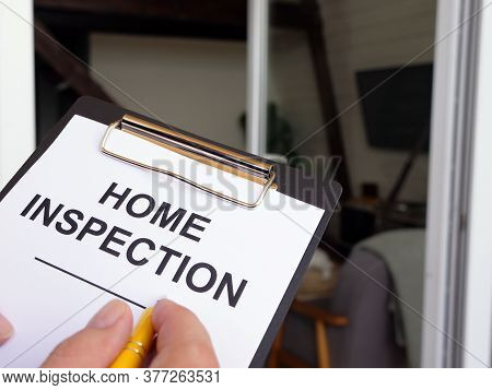 Inspector Fills Out The Home Inspection Form.
