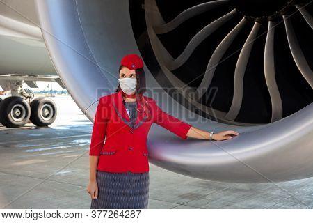 Kyiv, Ukraine - July 1, 2020: Turkish Airlines Flight Attendant Standing Near Airplane Engine. Boein