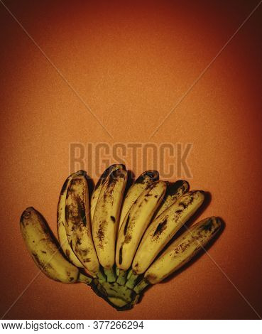 Bunch Of Bananas On Red Background With Vignette And Copyspace. Fresh Organic Banana Overripe, Fresh