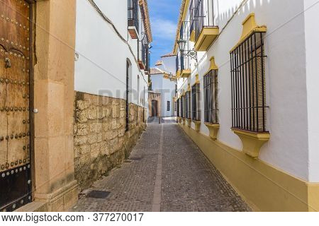 White Houses In A Historic Narrow Street Of Ronda, Spain