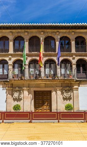 Flags At The Facade Of The Historic Town Hall Of Ronda, Spain