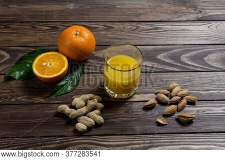 Orange Juice And Sliced ​​orange. A Glass Of Orange Juice, A Whole Orange And A Sliced ​​orange On T