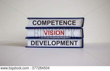 Books With Text 'competence Vision Development' On Beautiful White Background. Business Concept. Cop