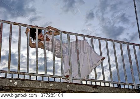 Woman At The Fence Of The Bridge
