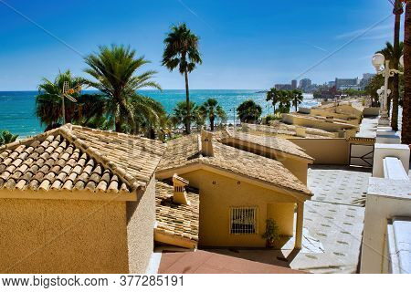 Malaga, Spain - September 01, 2015: Few Similar Looking Shed House Next To Beach Before Palm Trees L