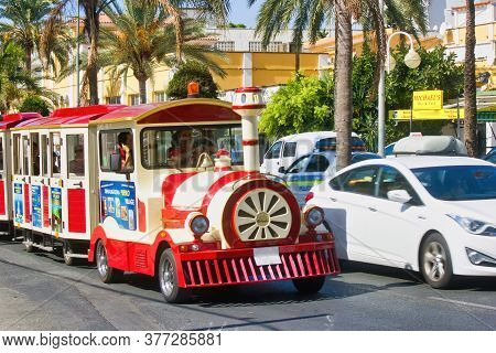 Costa Del Sol, Spain - September 02, 2015: A Toy Train On A Road Carrying Tourists In A Region Of An