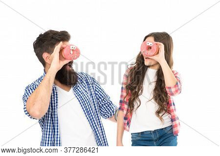Cheerful Family. Sweets And Treats Concept. Daughter And Father Eat Sweet Donuts. Dessert. Happiness