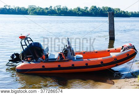 Rigid Inflatable Boat Out On Sea Near An Island On A Sunny Day