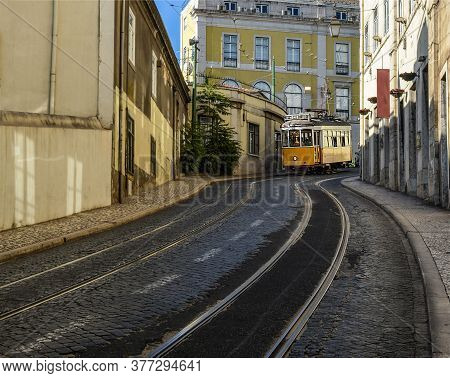 Vintage Yellow Tram (line 28) In The City Center Of Lisbon, Portugal.