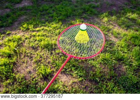A Racket Accompanied By A Shuttlecock To Practice Badminton. Horizontal Format.