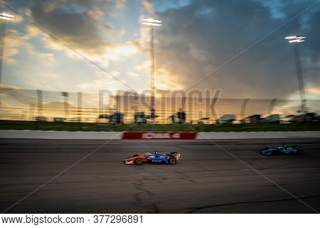 July 18, 2020 - Newton, Iowa, USA: SCOTT DIXON (9) of Auckland, New Zealand  races through the turns during the  race for the Iowa INDYCAR 250s at Iowa Speedway in Newton, Iowa.