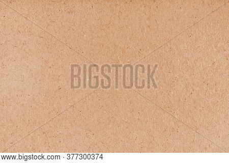 Cardboard Grunge Recycled Craft Paper Texture With Fiber And Grain. Brown Grainy Corrugated Cardboar