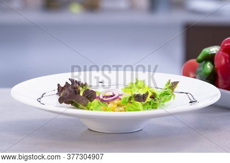 Delicious Scrambled Eggs With Lettuce And Purple Onion Slices