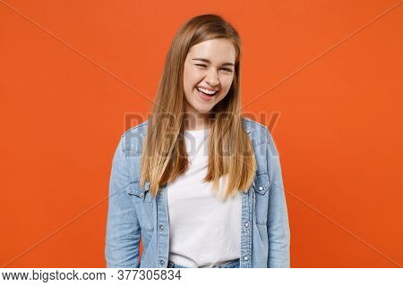 Funny Young Woman Girl In Casual Denim Clothes Posing Isolated On Bright Orange Wall Background Stud