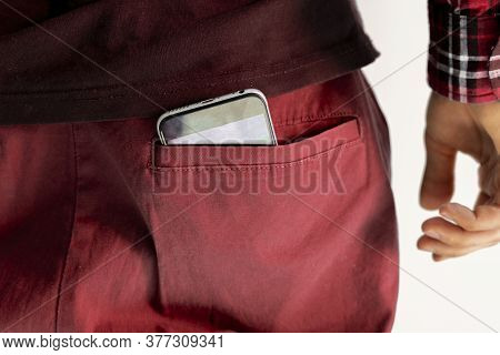 A Close Up Smartphone Inside The Pocket Of Male Clothes, Back View, As Symbol Of Health Effect From