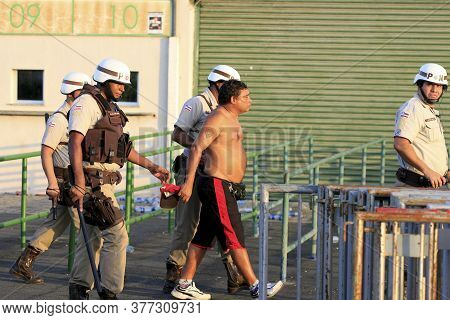 Salvador, Bahia / Brazil - April 13, 2014: Military Police Officers Are Seen During The Arrest Of Su