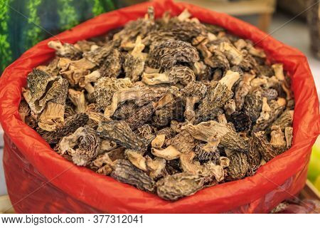 Bag Of Dried Morel Or Morchella Mushrooms For Sale In At An Outdoor Farmers Market In Old Town Kotor